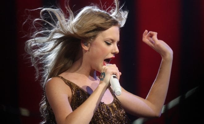 Taylor Swift Singing in Gold Dress